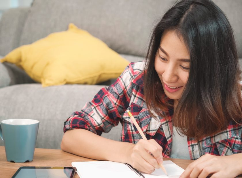 Asian student woman do homework at home, female using tablet for